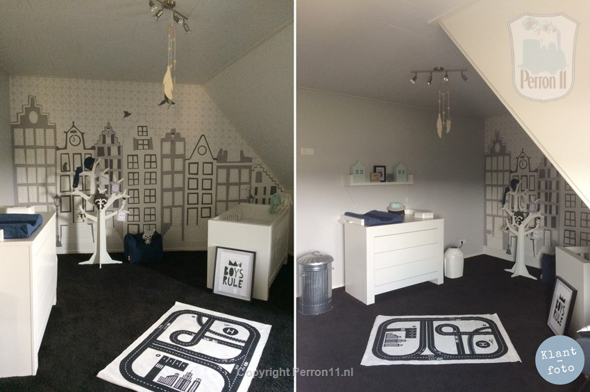 baby room with poster wallpaper canal houses under pitched roof