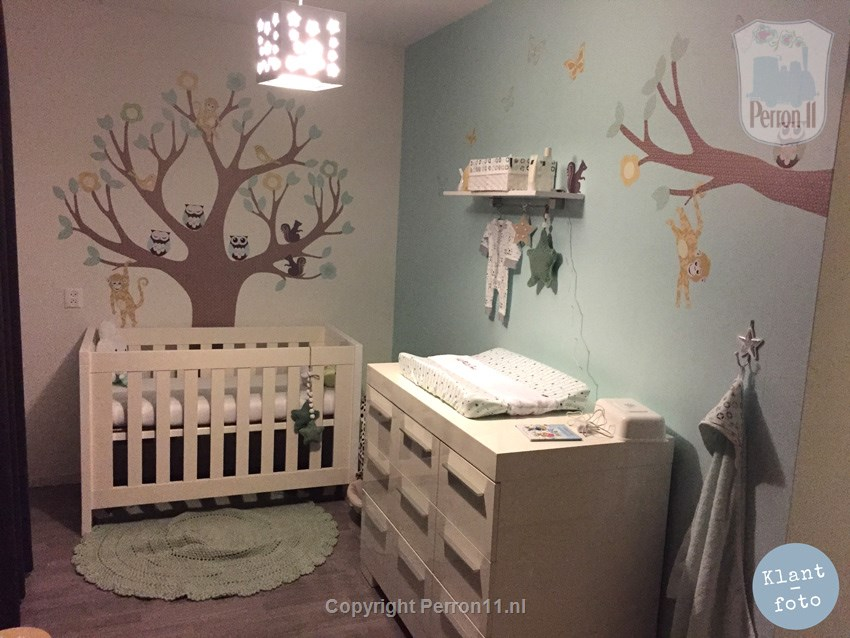 Baby Furniture with soft pastel shades and wall sticker tree